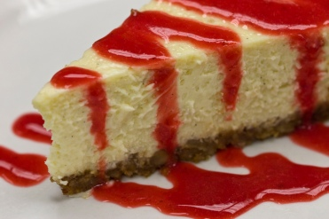 Mondays_at_Il_Forno_-_Cheesecake_with_strawberry_sauce